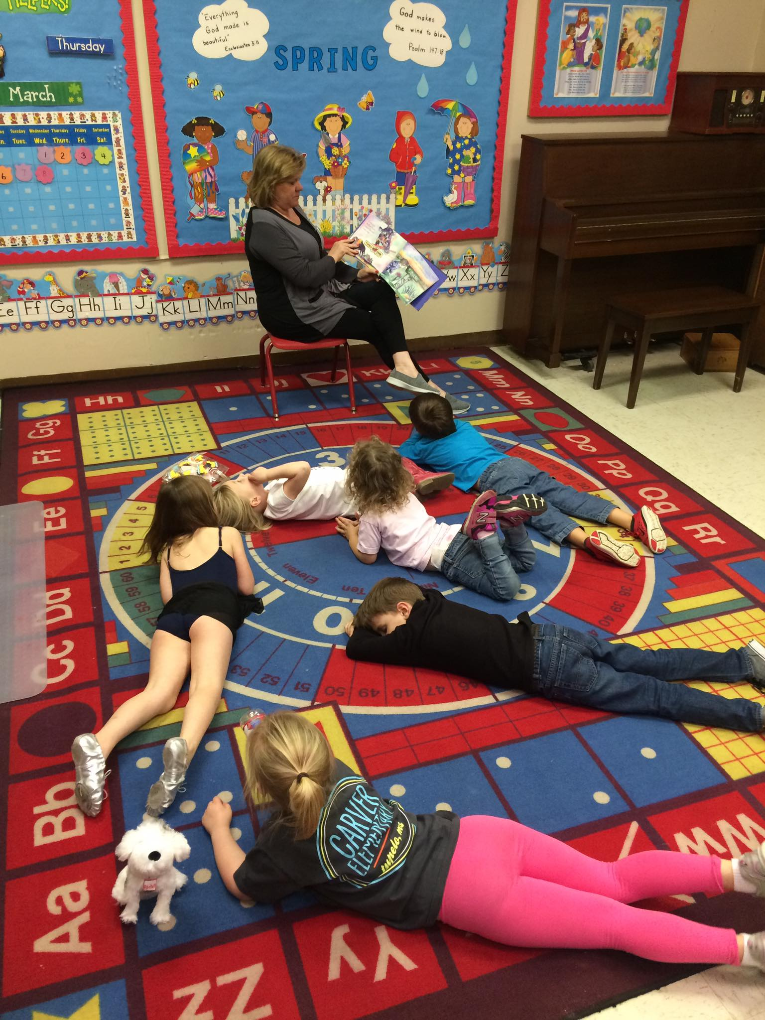 """The Cherubs get sleepy while Miss Kathy reads Brittany Rogers' """"Goodnight Tupelo."""" Being a Cherub is rough sometimes."""